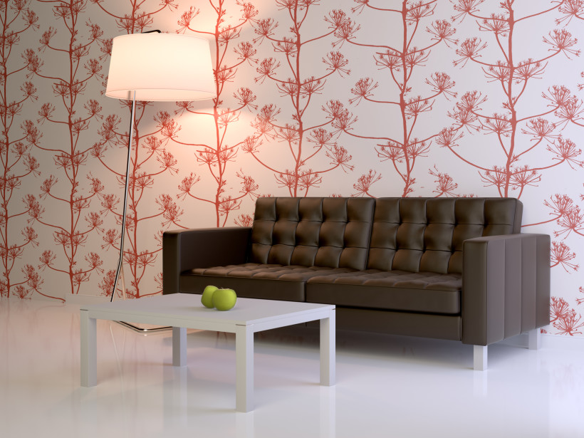 Beautiful modern patterned red and white floral type wallpaper with contrasting sofa and trendy lamp