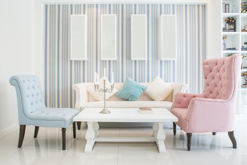 Classic vintage style furniture and vertical lined wallpaper with four blank wall canvasses