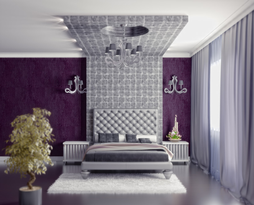 Modern style bedroom interior with purple fabric wallpaper and grey block effect feature over the bed