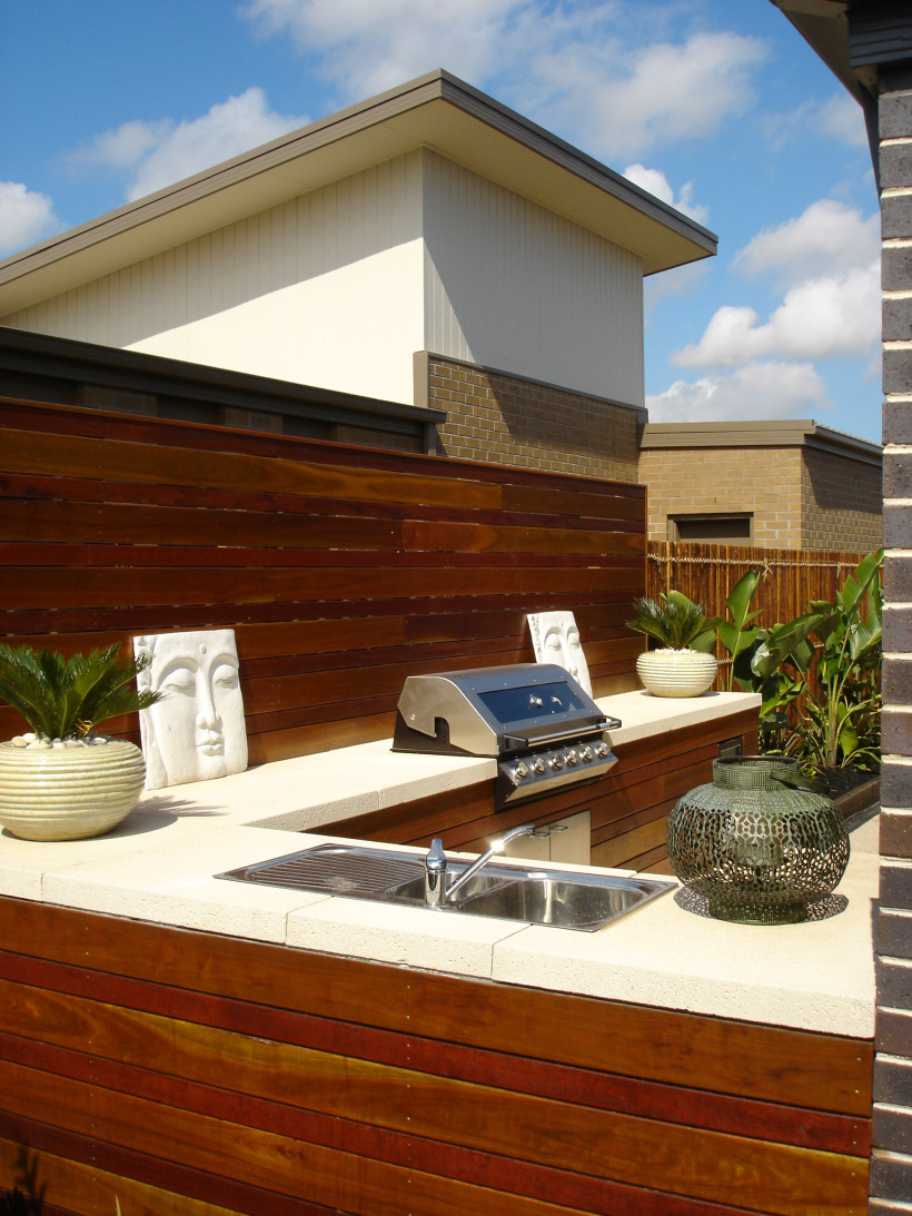 open air kitchen with bench top sink area barbecue and wash up sink