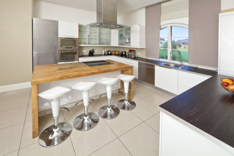 Luxury Kitchen With Dark Timber Bench Top And Solid Timber Dining Island