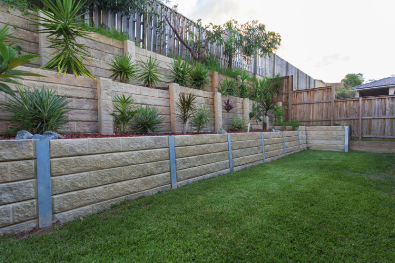 Tiered Backyard Pictures : Garden block multi level tiered retaining wall with plants in backyard
