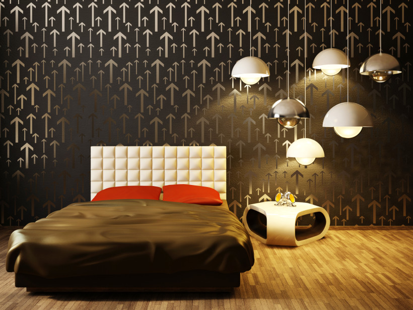 Luxurious modern interior bedroom with interesting up arrow design wallpaper, matching lights and a contrasting cream headboard