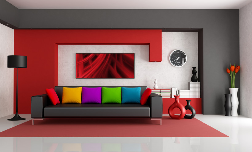 Contemporary red white and black modern living room with black couch concrete wall with colorful matching art picture