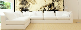 Interior design of modern white living room with big white sofa, beige colored painted walls and massive contemporary wall mural