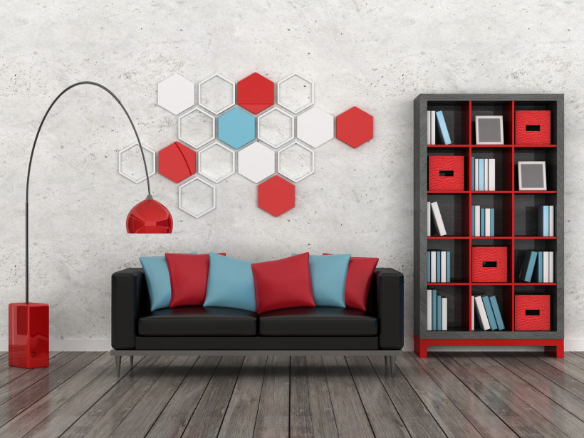 Fascinating unpainted concrete wall with a number of featured multi colored hexagonal shapes and matching furnishings