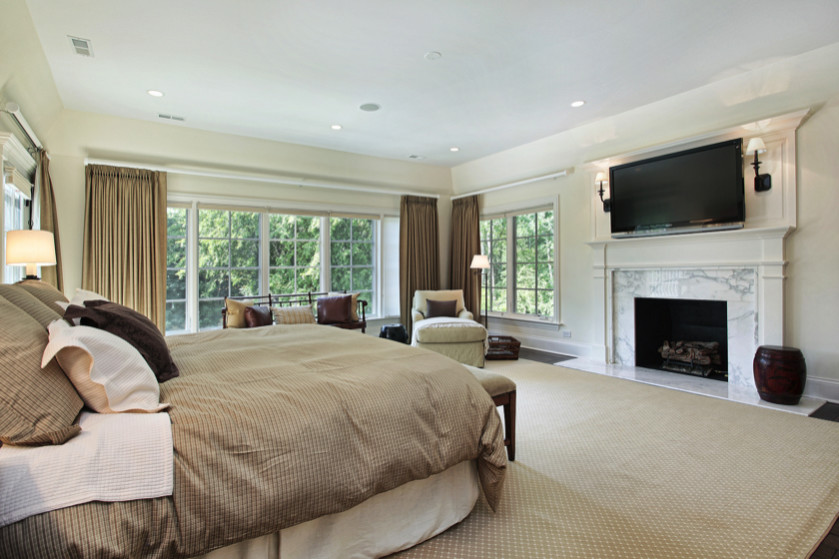 large master bedroom with neutral tan and white soft furnishings