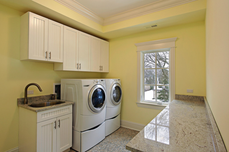 Modern Laundry Room With Marbletop Folding Bench