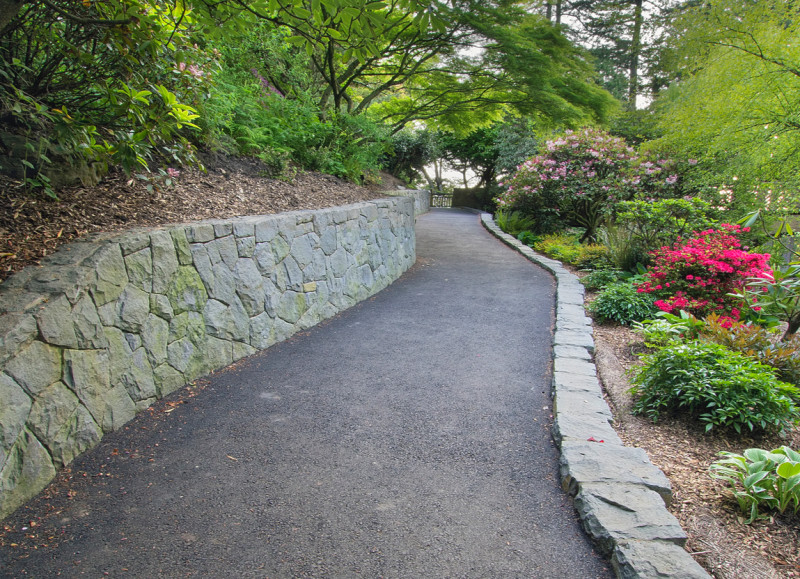 retaining rock wall along walking path