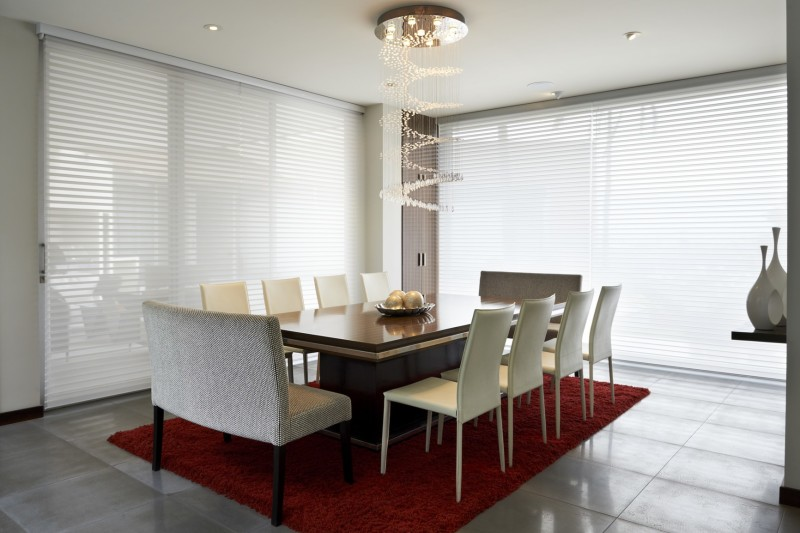 stylish modern dining area with extra long timber dining table and seating for ten via eight - Extra Long Dining Room Table Sets