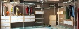 A very modern interior view of a contemporary and expansive woman's walk in wardrobe