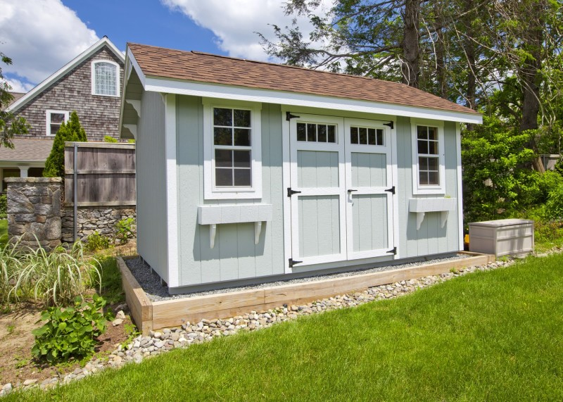 modern garden shed painted grey with white highlights twin windows double barn doors and