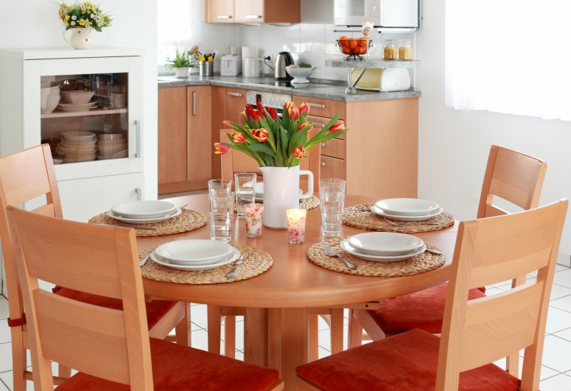 A Humble Dining Table And Four Piece Chair Setting In Alight Grained Wood That Matches The