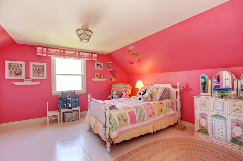 beautiful girls room with bright pink colored walls carved wooden bed
