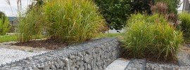 Brilliant examples of Gabion retaining rock walls used as a practical feature