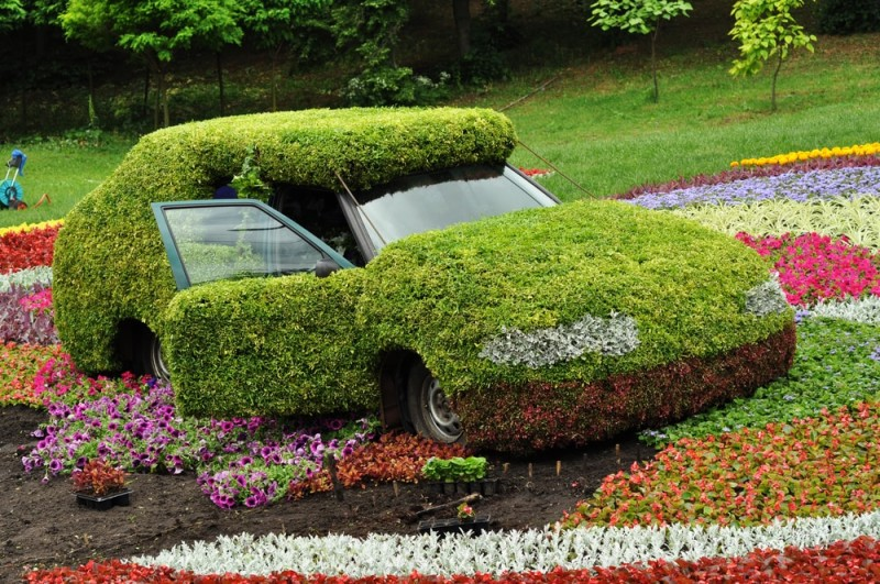 Car decorated with grass in the park - not topiary, but definitely art
