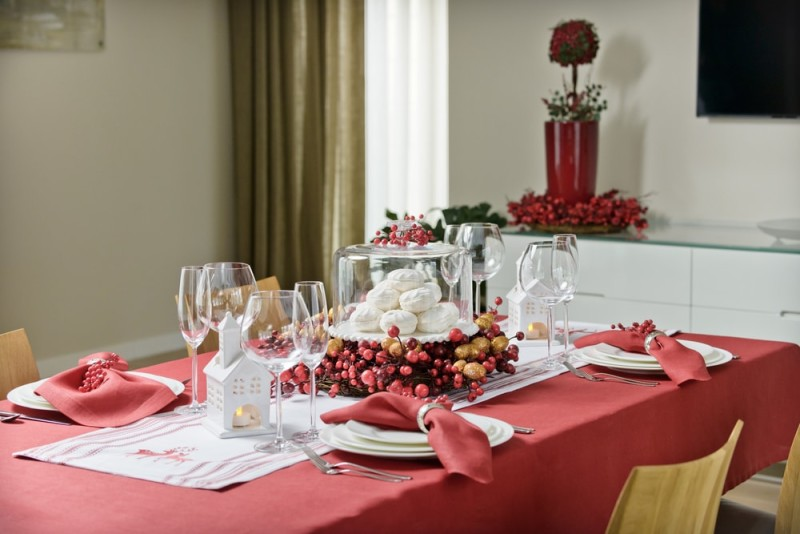Four place setting dining table set out and decorated for the Christmas holidays with Christmas tree and red tablecloth & 27 Modern Dining Table Setting Ideas