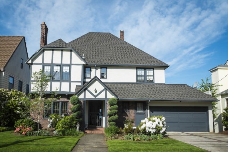 Classic house design ideas traditional home design photos for Tudor style house for sale