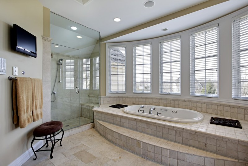 Master Bathroom In Luxury Home With A Tiled Step Up Bath Tub Directly Beneath Set Of