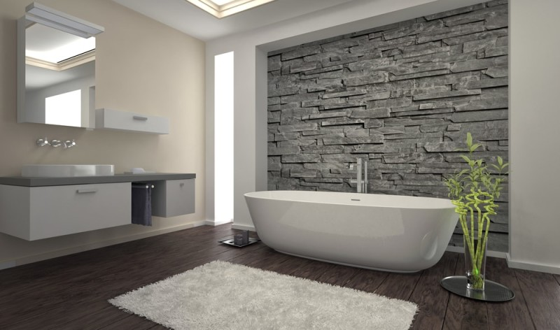 Modern bathroom interior with beautiful feature stone wall and contemporary  stunning bath tub. Interior Designs for Bathrooms with Modern Bathroom Tub Designs