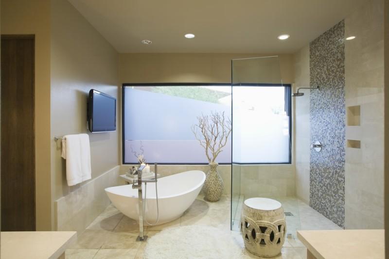 Modern bathroom with relaxing elegant free standing white soaking bath