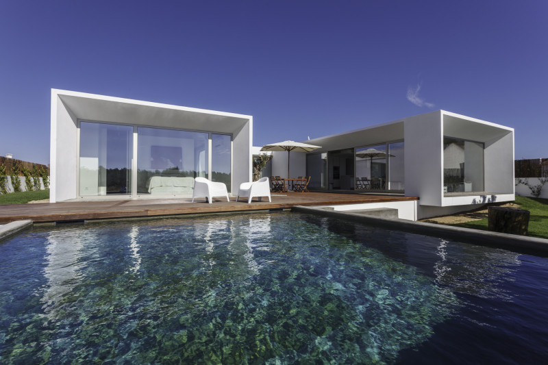 modern architectural house design showing a modern contemporary house with garden swimming