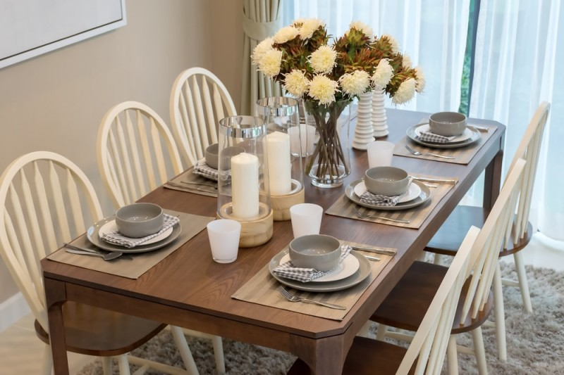 modern dining room table with simple but stylish wooden chairs