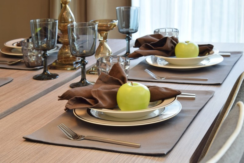 Wooden Dining Table With Modern Styled Place Settings