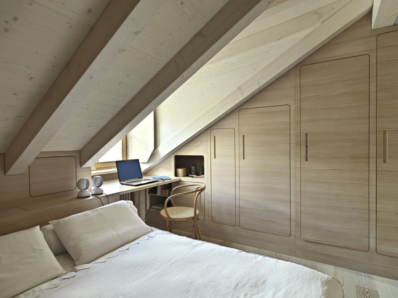 interior view of a rustic bedroom in a smallish attic room with wooden ...