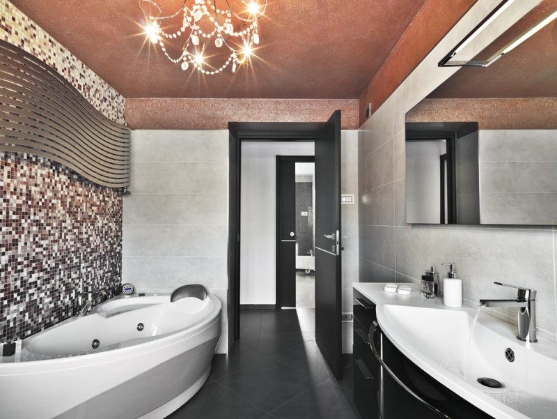 Modern contemporary bathroom with custom white bath tub and jets and washbasin