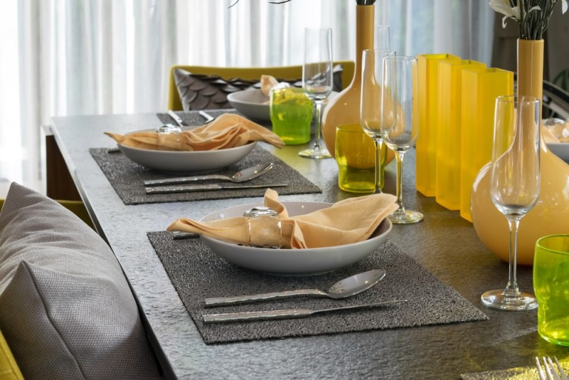 Dining Room Table Settings Served With A Plate On The Table And Yellow  Napkins And Grey Table Mats