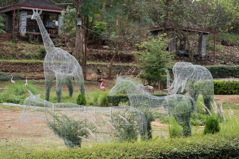 Topiary art planting pot wire animal shapes in garden