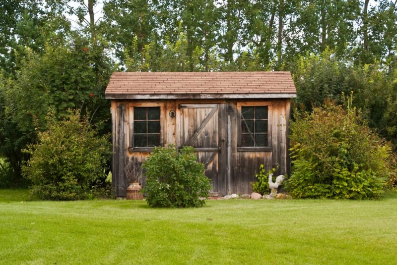 A charming, rustic garden shed room made from reclaimed barn board timber
