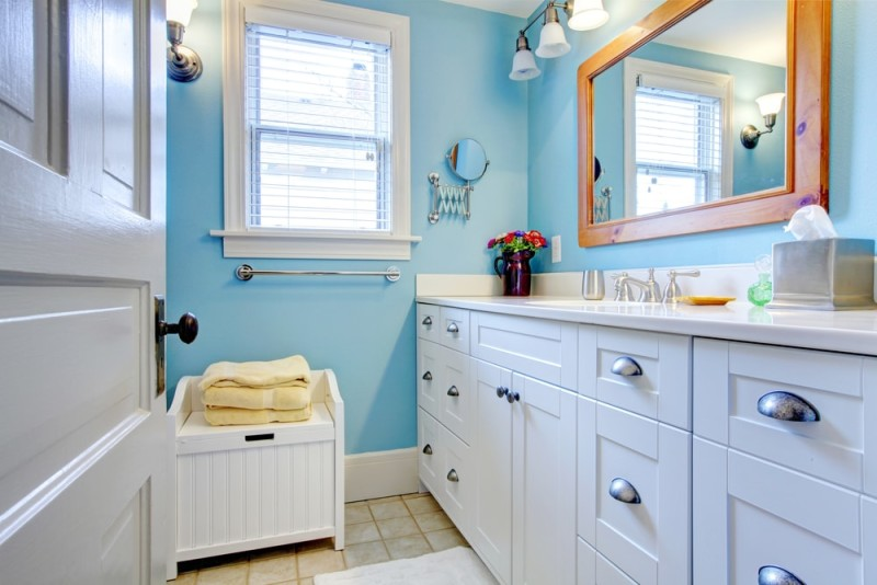 Blue and white bathroom with lots of storage space with open door min e1437858001752 - Blue and White Interiors