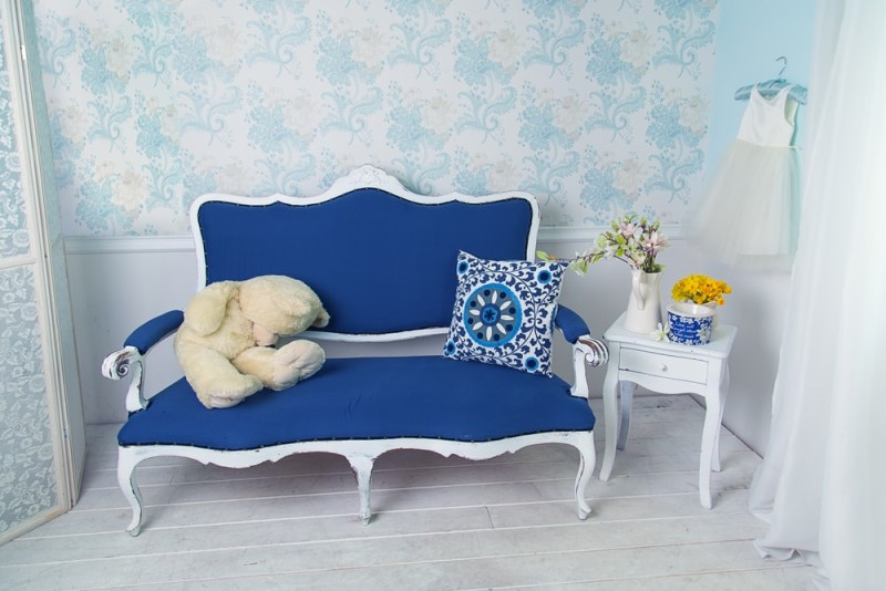 Blue classical style sofa couch with white teddy bear in vintage room min e1437858127297 - Blue and White Interiors