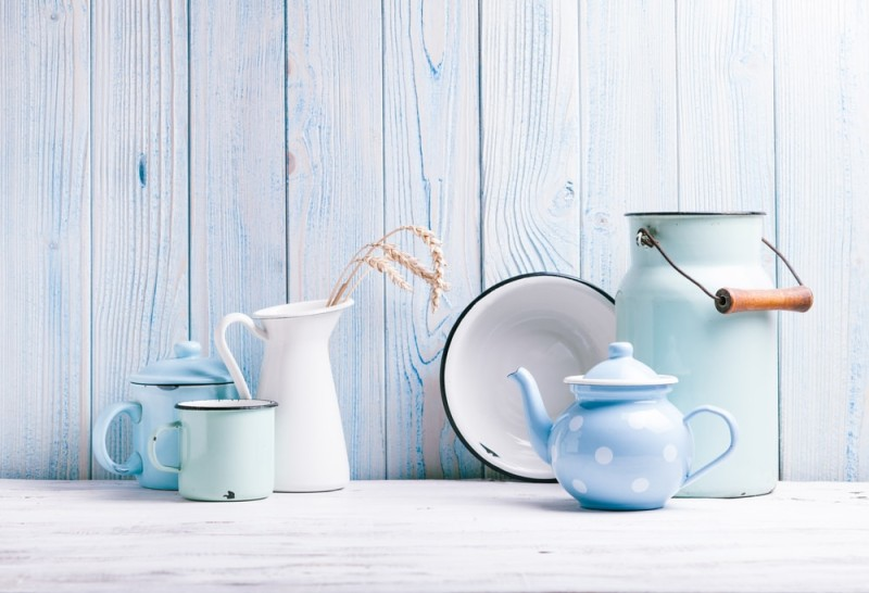 Enamelware on the kitchen table over blue wooden wall min e1437860120966 - Blue and White Interiors