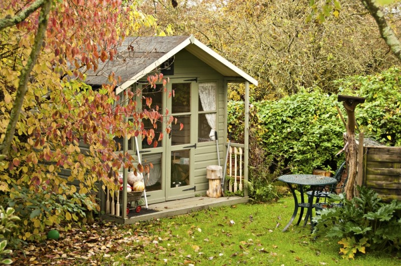 Summerhouse room at the bottom of the garden surrounded by fall leaves