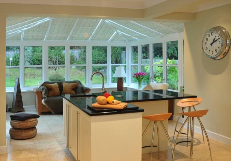 Interior of a modern kitchen with beyond a conservatory and garden min e1436698410127 - 15 Fantastic Modern Conservatories and Sunroom Makeover Ideas