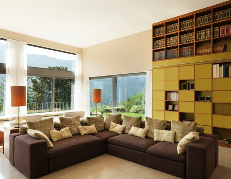 Modern Living Room With Large Comfortable Divan And Extensive Full