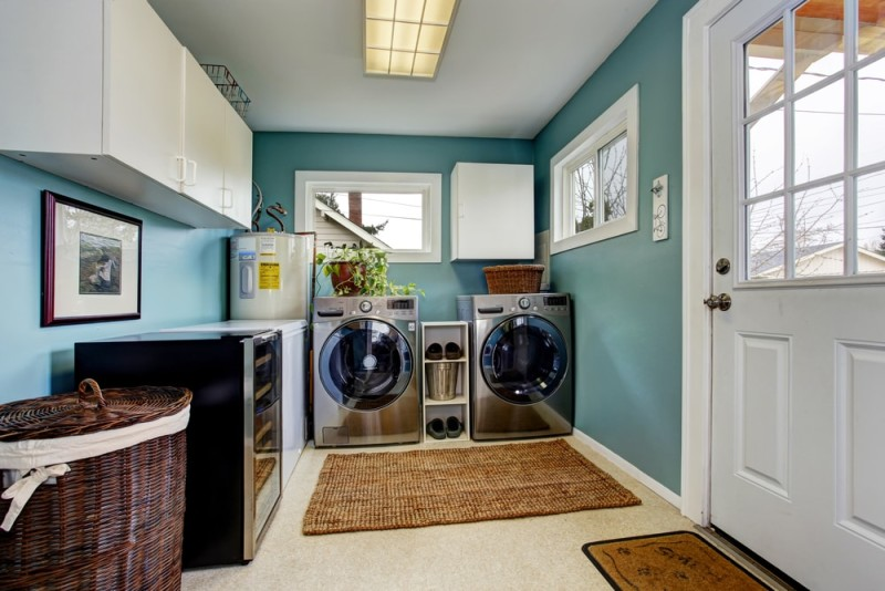 Light blue laundry room with modern steel appliances and white cabinets min e1437858164643 - Blue and White Interiors