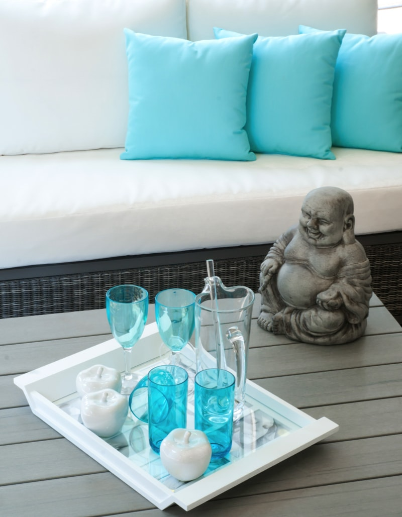 Modern garden furniture with Buddha statue on the table min - Blue and White Interiors