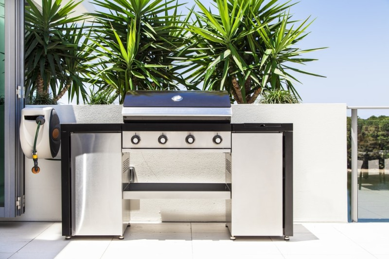 New stainless steel barbecue grill on modern balcony1 min e1438109684431 - Ideas for Outdoor Kitchens