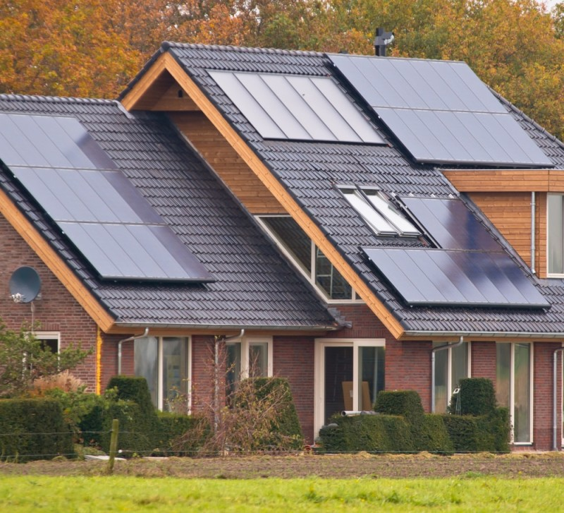 Photovoltaic Solar Panels on Newly Built Modern House min e1437008998357 - Solar Roof Panels and Residential Solar Energy Systems