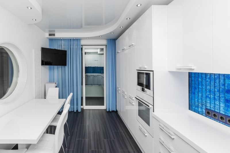 Modern White And Blue Kitchen Dining Room With Built In Household Appliances