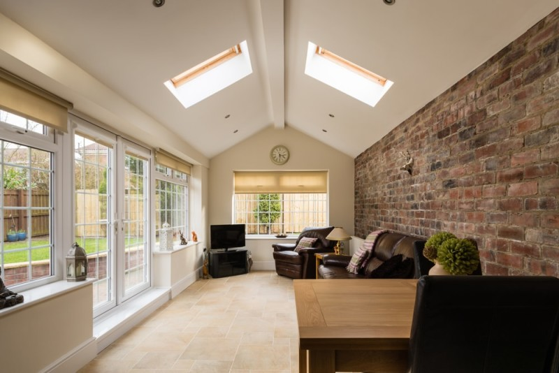 Sun Room Modern Sunroom or conservatory extending into the garden with a featured brick wall min e1436698687756 - 15 Fantastic Modern Conservatories and Sunroom Makeover Ideas