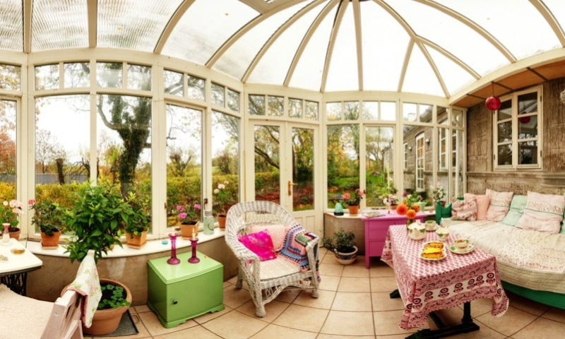 conservatory interior with sofa and chairs. panoramic image of glass extension min e1436698800135 - 15 Fantastic Modern Conservatories and Sunroom Makeover Ideas