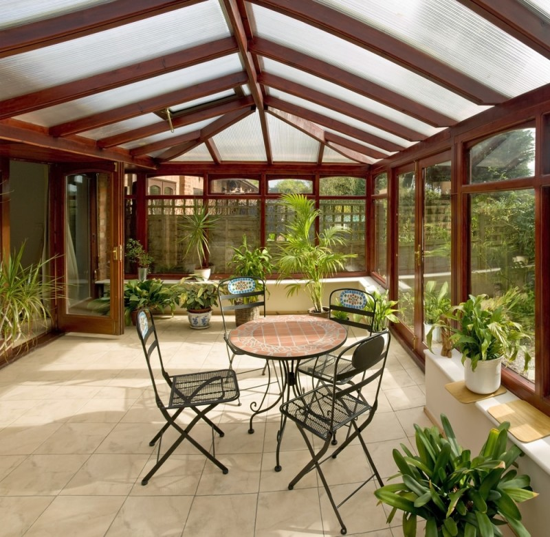 conservatory tables chairs plants room in house next to garden2 min e1436698898819 - 15 Fantastic Modern Conservatories and Sunroom Makeover Ideas