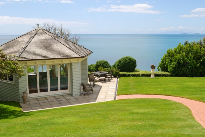 Outdoor Garden Rooms -Large elegant gazebo room with sea vista, manicured lawn and blue sky background