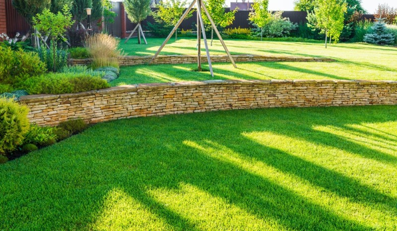 Tiered Backyard Pictures : gorgeous landscaped fenced yard area with tiered rock wall designs