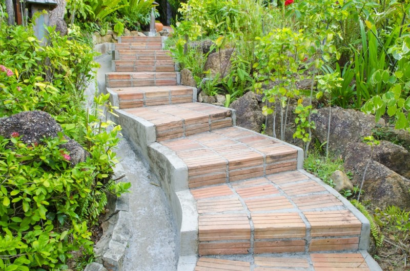 Beautifully crafted brick stepped pathway immersed in a garden landscape